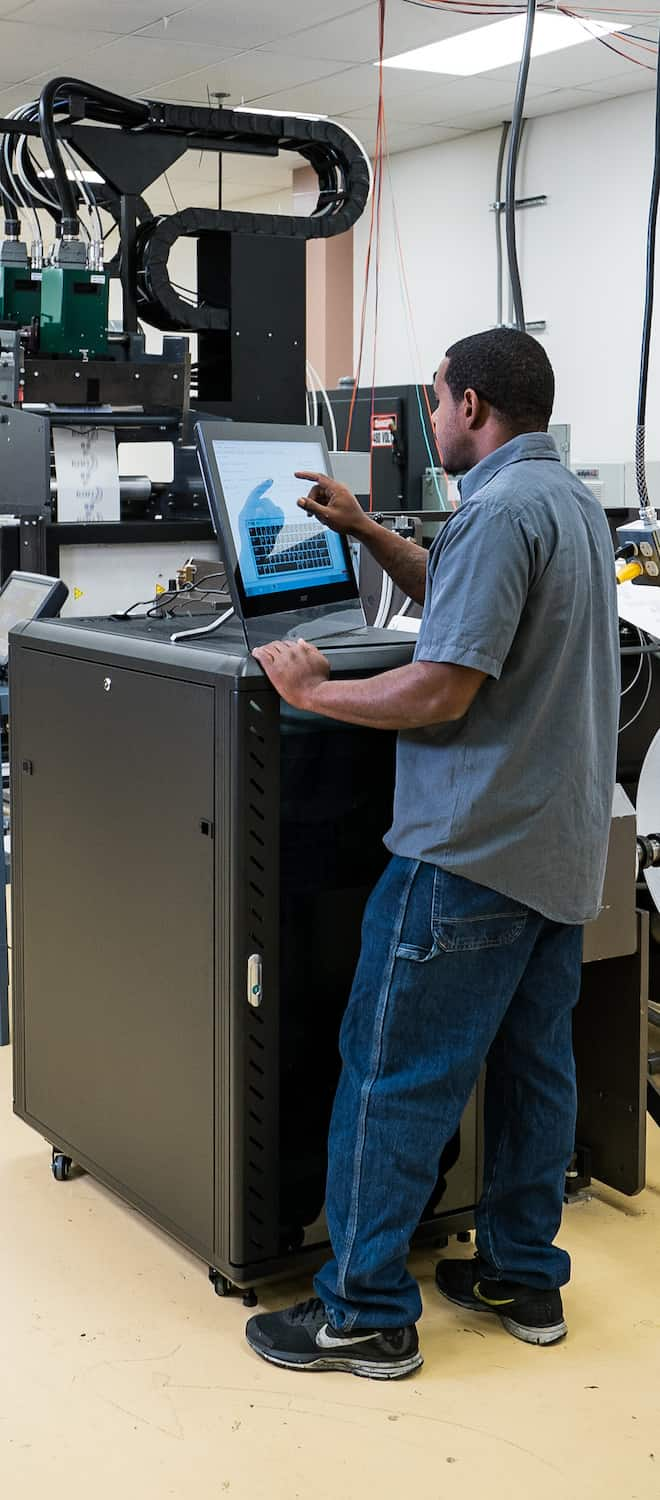 Kao Collins employee operates X-bar controller